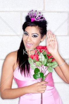 happy young female fashion model holding a bouquet. - Portrait of a happy young female fashion model holding a bouquet, Model: Sabrina Ramkissoon