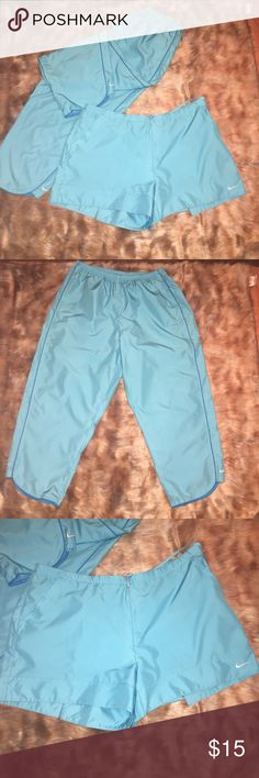 LADIES BRAND NEW WITH TAGS  NIKE SET SIZE XXL TWO PIECE CAPRI PANTS AND SHORTS NIKE SET CAPRIS HAVE TWO FRONT POCKETS WITH ELASTIC DRAWSTRING WAIST FRONT ZIPS UP SHORTS HAVE TWO FRONT POCKETS ZIP UP FRONT AND DRAWSTRING WAIST BACK TWO POCKETS ZIP UP Nike Other