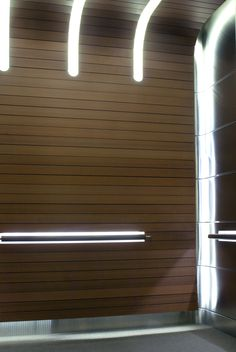 One of a Kind Elevator Interior Design. The RBC Dexia Masks all Light Sources Behind Solid Wood Slated Finger Coves, Illuminated Handrail Bands, and Polished Horizontal Grain Stainless Steel Wall Panels.