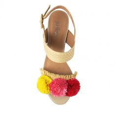 Crafted from an amazing neutral straw woven textile, these sandals are a classic silhouette with a seriously fun twist. With a multi coloured rafia pom pom detail, and a 5.5cm* wedge style block heel, Aslie is a carnival of colour and style packed in to o