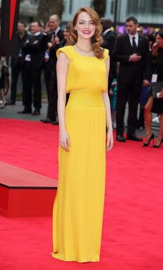 """Emma in Versace–Following up her pantsuit look earlier this week, actress Emma Stone delivered full feminine, retro glamour in an Atelier Versace gown at """"The Amazing Spider-Man 2″ premiere held in London on April 10th. The custom-made yellow gown goes perfectly with Emma's red tresses. The film star paired the look with Christian Louboutin shoes and jewelry by David Webb.   Images: Versace/Getty Related"""