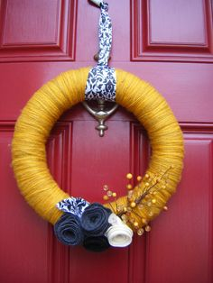 Mustard yellow yarn-wrapped wreath with black, white and charcoal gray accents - super stylish!