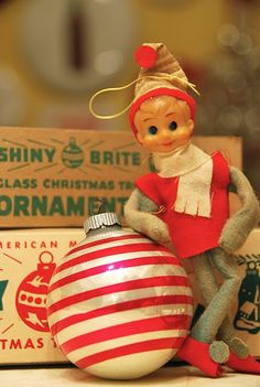 Vintage Christmas ornaments, a red and white shiny bright along with a cute little elf ornament.