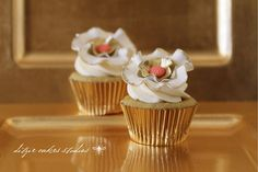 Gold Accented White Flower Wedding Cupcake
