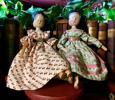 These two little peg dolls have dressed up a dusty book shelf that has been decked with Christmas Holly. Wooden Figurines, Wooden Dolls, Clothes Pegs, Doll Clothes, Clothespin Dolls, China Dolls, Handmade Dolls, Primitives, Paper Mache