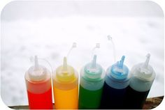Colored water in squeeze bottles for drawing in the snow. Totally doing this this winter...
