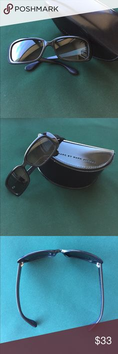 Marc by Marc Jacobs Black 040 Sunglasses These Marc By Marc Jacobs 040 Sunglasses are in black plastic frames with black Polarized lenses.  Designer's holographic initials decorate the arms.  Comes with the protective case.  The arms are uneven, with the left being more curved inward (see photo 3). Some minor scratches on the lenses and a nick on the right outer frame (see photo 4).  Comes from our smoke-free, pet-free home.  Gearing up for a big move so offers are welcome :-) Marc by Marc…