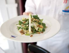 An endive and frisée salad with Fourme d'Ambert cheese, walnuts, and pear in a sherry vinaigrette, at Blue 1.