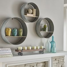 IMAX Laurel Round Wall Shelves Set of 3 There's a time for every re-purpose. This trio of round wall shelves makes the most of the found-object look with its combination of wood plank shelves and galvanized metal mesh frames. Wood Plank Shelves, Metal Shelves, Plank Of Wood, Shelves In Bedroom, Diy Wall Shelves, Shelving Ideas, Book Shelves, Circle Shelf, Round Shelf