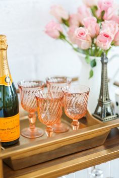 Champagne + pink roses + coral glasses.