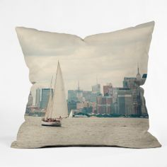 Catherine McDonald Sail NYC Outdoor Throw Pillow | DENY Designs Home Accessories #newyorkcity #chryslerbuilding #nautical #photography