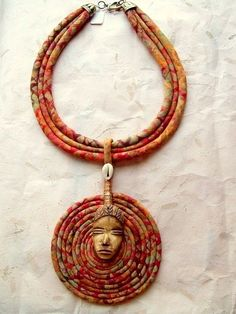 Batik Tribal Cord  Necklace with Ethnic Bone by paintedthreads2, on Etsy----like the style but not the face