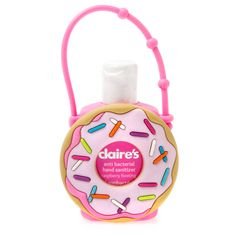 """<P>Keep your hands free of germs when you're on the go. This cute donut with sprinkles holds a bottle of raspberry frosting scented anti-bacterial hand sanitizer. Adjustable strap lets you attach it to your backpack or purse.</P><UL><LI>2""""L x 3 3/8""""H<LI>1.0 fl. oz.</LI></UL>"""