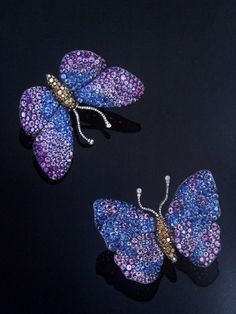 JAR Paris. A PAIR OF EXQUISITE MULTI-GEM BUTTERFLY EARCLIPS, BY JAR. Each with circular-cut sapphire and amethyst undulating wings to the pave set coloured diamond body and single-cut diamond antennae, mounted in silver and 18K gold, in a JAR pink leather fitted case. Signed JAR. Price Realized $138,697 / Estimate $36,403 - $50,965. [C. PRIVATE COLLECTION 17 May 1999 - Geneva] ///// A PAIR OF EXQUISITE MULTI-GEM BUTTERFLY BROOCHES, BY JAR. Each with circular-cut sapphire and amethyst…