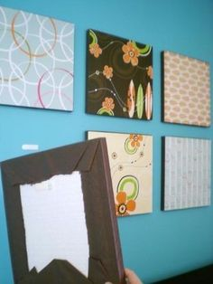 Pizza boxes covered in beautiful wrapping paper. Who knew it was so cheap and so easy to decorate your walls?!