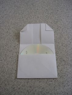 How to Make a Folded-Paper CD Case by DIY Maven, curbly #DIY #Paper_CD_Case #DIY_Maven #curbly