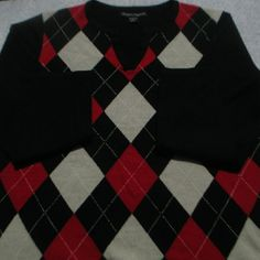 """Black White Red Argyle V Neck Sweater Nice looking argyle pattern sweater that is in good condition with only gentle wear. 100% Acrylic, pullover, V neck. With garment laying flat measurements are 22"""" chest, 17"""" shoulders, 16"""" arm pit to bottom hem, 22"""" length, 20"""" waist, 23"""" sleeve. Designer's Originals  Sweaters V-Necks"""