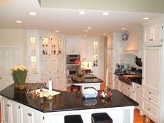 Expansive gourmet kitchen is filled with premier appliances & Roecker cabinets.