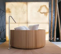 A traditional Japanese soaker tub with hints of a Swedish spa, this modern bathtub by an Italian company Puntoacqua  brings a little luxury to be enjoyed every day. Finished in Canadian cedar, it boasts an organic round shape that can be made to your size specifications.