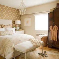 bedrooms - trellis wallpaper, moroccan wallpaper, gray moroccan wallpaper, quatrefoil wallpaper, moorish tile wallpaper, armoire bedroom armoire, french bench, wallpaper accent wall, bedroom with wallpaper accent wall, wallpapered accent wall, french chandelier, cowhide rug,