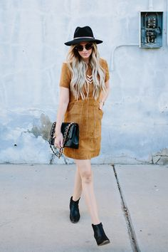 Rock a super soft tan suede dress with a retro bohemian vibe with black…