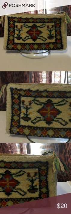 Vintage carpet /tapestry purse festival Bohemian Vintage carpet /tapestry purse festival Bohemian. This is more of a large change purse. It is a great bohemian accessory. It is 7 1/2 by 4 1/2 and the zipper is metal and still works. I would be gentle with it. It is a beauty! Bags Clutches & Wristlets