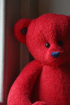 An adorable red teddy bear