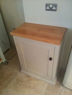 The brief was simple, build a cabinet to hide a large water softener to match an island we just had installed. But it had to fit in a very tight space between where a rolling butchers block would stand, and the fridge, the door of which was very deep, and needed a good 5 inches of clearance to open sufficiently. phew!
