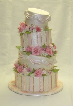 Old Fashioned Romance wedding cake ~ tiers with handmade gumpaste flowers filling the spaces.