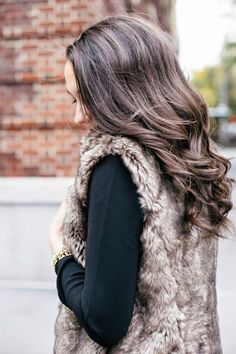 Light brown fur vest, black shirt