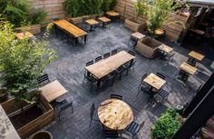 Front Street Cafe's garden patio offering outdoor dining and workspace. Located in Philadelphia, PA this establishment is a combination coffee shop, juice bar, full restaurant & bar with outdoor garden patio & upstairs event space. The menu offers fresh farm-to-table, organic cuisine, with many vegan and gluten-free options.