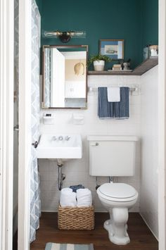 Joseph's bathroom had some decent bones, but needed a light and renter-friendly makeover. See what we did...