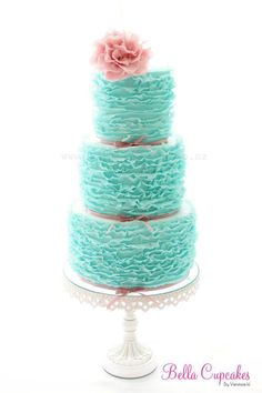 Gorgeous diamond blue wedding cake with ruffles.