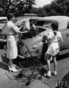 Mother and daughter loading car with groceries. Garden City, 1942.  By Alfred Eisenstaedt