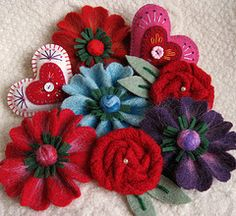 felted wool flower and heart brooches made from pieces of upcycled wool sweaters