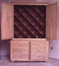 I might actually faint from happiness if I could have this for yarn storage. Cabinet with wine storage type diagonal dividers, plus drawers below.