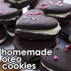 Make these easy and delicious Homemade Oreo Cookies in heart shapes!Perfect for Valentine's day or any party as it has pretty sprinkles and cream filling. Watch the video tutorial and see how quick I made these chocolatey cookies! Homemade Oreo Cookies, Oreo Cookie Recipes, Keto Cookies, Oreo Desserts, Heart Shaped Cookie Cutter, Cookies From Scratch, Vegetarian Chocolate, Chocolate Flavors, Text Features