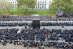 Crowds of people: The nation came together for the annual Service of Remembrance at the Cenotaph in Whitehall (pictured)