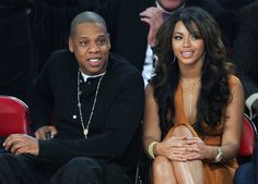 Beyonce Knowles Photos - Music artists Jay-Z (L) and Beyonce Knowles watch the 2007 NBA All-Star Game February 18, 2007 at the Thomas & Mack Center in Las Vegas, Nevada. - File: A Look Back at Beyonce And Jay-Z
