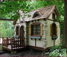 Too cute... very Disney cottage with the exposed rocks in the stucco....