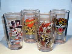 Ed Hardy 16 Oz Pint Glass Signature Prints Set of 4 EH6920  Assorted classic and original prints in this set Love Kills Slowly, Tiger, Koi Fish, Gambler Skull Each Glass Features The Print On One Side And The Ed Hardy Log On The Other, and Don Ed Hardy Designs On The Bottom. Great Gift for someone who loves Ed Hardy and contemporary design of Tattoos.