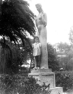 A childhood photo, date unknown, of Echo Park resident Shirley Sousa posing before the Lady of Lake