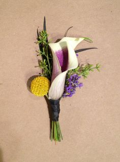 calla lilly with yellow billy ball and local foliage. @Lucy Kemp's Informal Flowers