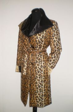 A fine leopard print coat with black satin lining.  Wide collar with embroidery of gold thread on the left lapel provide complete uniqueness of this extraordinary piece.