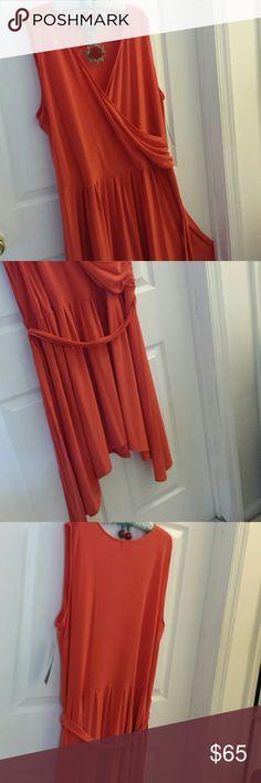 Ralph Lauren orange dress Ralph Lauren dress in orange, with shark bit hem and matching wrap around belt. A stunning dress that can go from work  to evening. Ralph Lauren Dresses