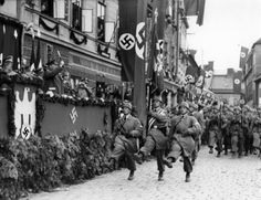 Parade of paratroopers in Austria, 1938/ The Hitler Youth Clubs were really military training under the branding of Youth Club. This is how Germany, denied the right to arm under Versaille, had a fully trained military when Hitler threw out the terms of surrender.