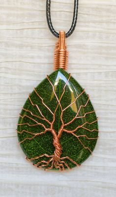 EARTH DAY RECYCLED Tree of Life wire wrapped around a Green Leaf Resin pendant . Pendant is 1 1/4 inches in length. All wire used in making this pendant is recycled copper (see details below). Drop ring incorporated into wire wrapping for easy use with a necklace of your choosing. Black cord necklace can be provided with pendant if specified in order.  Recycled Beautifully is proud to say that We Recycle! All of our hand wrapped jewelry is made using recycled copper or aluminum wire that...