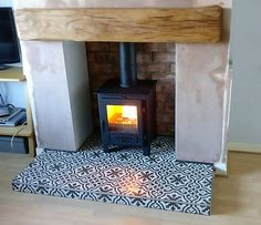 Stoves Beams and Hearths. Fireplace Hearth Tiles, Gas Stove Fireplace, Wood Burner Fireplace, Build A Fireplace, Wooden Fireplace, Home Fireplace, Fireplace Design, Fireplaces, Corner Log Burner
