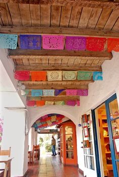 Paper cutouts decorate a walkway at Old Town San Diego State Historic Park, which honors the pueblo and its roots.