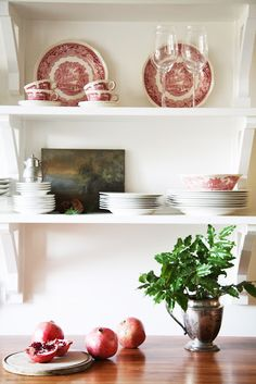 Open shelving with red and white crockery.  Styled for Christmas.